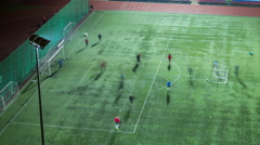 People playing football on the green field at evening time, timelapse, 4K - stock footage