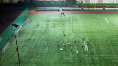 Football training at green field, timelapse, evening, 4K Stock Footage