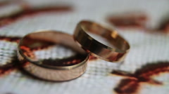 Spinning wedding rings close-up - stock footage