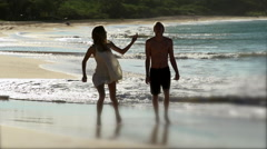 Attractive couple frolic on Big Beach Maui Stock Footage