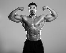 Bodybuilder posing - stock photo