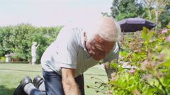 Senior gentleman doing some gardening at home Stock Footage