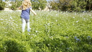 Stock Video Footage of Little girl running in grass field happy