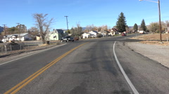 Entering small rural town drive POV 4K 002 Stock Footage