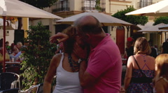 Couple kiss for the camera on Spanish street Stock Footage
