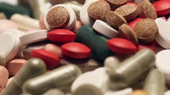 Rotating pile of pills Stock Footage