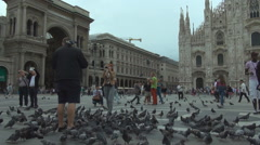 People enjoy relax Galleria Vittorio Emanuele II Dome cathedral Milan square day Stock Footage