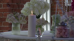 Dessert table decorated with white flowers Stock Footage