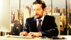 Handsome business man working in office in New York with pc writing email Stock Footage