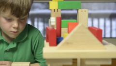 Young boy playing with blocks - stock footage