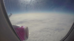 Turbulence high above clouds aircraft few kilometers above land, click for HD - stock footage