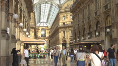 Tourist people enjoy shopping Galleria Vittorio Emanuele II Milan commercial day - stock footage