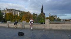 4K Man playing bagpipe in Edinburgh, Scotland Stock Footage