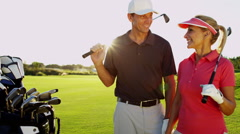 Stock Video Footage of Outdoor Recreation Lifestyle Golf Player Male Female Caucasian Vacation Portrait