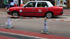 Red taxi waiting for customers on Causeway Bay street in Hong Kong, China Stock Footage