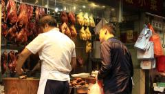 Chinese traditional local food store at Causeway Bay road - stock footage