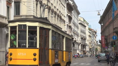 Old tram pass downtown Milan city day narrow street vintage public transport way Stock Footage