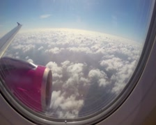 Aircraft flying near clouds sunny flight, wing turbine blue sky, click for HD - stock footage