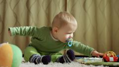 Baby boy reaching for toy car 4k Stock Footage