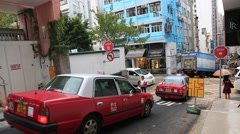 Cars and people on narrow road at Soho area in Hong Kong Stock Footage
