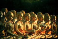 Arrangement stack of golden buddha statue in buddhism temple thailand Stock Photos