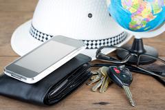 Keys and world travel concept Stock Photos