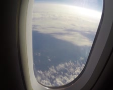Porthole view turbulence aircraft in clouds, passenger view look, click for HD Stock Footage