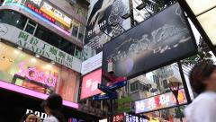 Commercial billboards and street information board at Causeway Bay road Stock Footage
