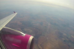 Airplane wing turbine, maximum height kilometers below land, air, click for HD Stock Footage