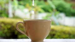 Teapot Pouring Boiling Water into a Cup Brewing Tea. Stock Footage