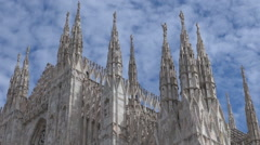 Beautiful Milan landmark Duomo Cathedral dome church cloud pass blue sky iconic  Stock Footage