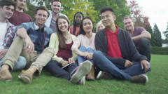 Happy close friends together outdoors Could be student group or young Christians Stock Footage
