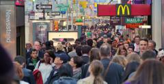 Crowd people walking 6th Avenue McDonalds restaurant in midtown Manhattan, NYC. Stock Footage