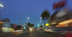 POV driving in LA at twilight by Melrose and La Brea Avenue. 4K UHD Timelapse. - stock footage