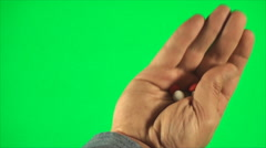 Hand Holding Pills On A Green Screen, Detail, Medical, Drugs, Front Shot Stock Footage