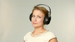 Beautiful adult woman listening music, isolated Stock Footage
