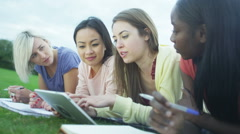 Cheerful female student group working together outdoors - stock footage