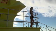 female lifeguard stands on the tower Stock Footage