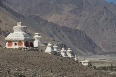 ibetan white pagodas with blue sky - stock photo