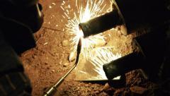 Welding underground water pipe 3/4 hd Stock Footage