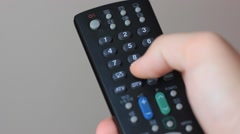 Remote Control in Hand Stock Footage