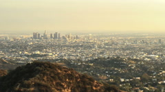 Wide angle timelapse of Los Angeles skyline and Hollywood as the sun goes down - stock footage