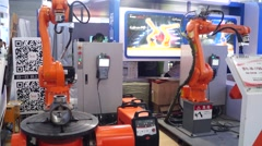 A robot working in the exhibition Stock Footage