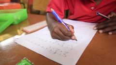 African child doing maths in classroom Stock Footage