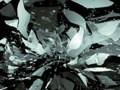 glass breaking pieces on black shallow dof - stock illustration
