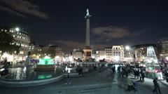 Crowdy Trafalgar Square London by night - stock footage