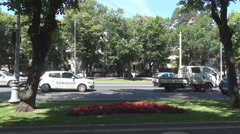 Moving vehicles on large boulevard in summer season, car traffic in green space Stock Footage