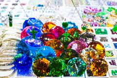 Bright gems and jewelry at shop display window Stock Photos