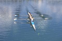 Four men rowing Stock Photos