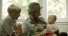 Father playing with children Stock Footage